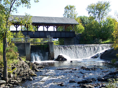 Our covered bridge over the dam and waterfall.